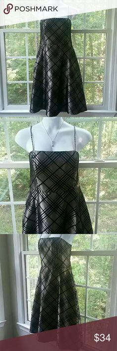 """🆕Jessica Howard Plus Size Party Dress Absolutely beautiful black and iridescent gold colored spaghetti strap special occasion dress. With all the holiday parties coming up your going to need this dress!   👗Spaghetti straps 👗Criss Cross pattern made of velvet.  👗55% Polyester 45% Nylon.  👗Lining 100% Polyester.  👗Zippered closure in back with eye hook.  👗Bust 20"""" Waist 18"""" Hips 26"""" Length 39-1/2"""".  👗Excellent condition, no issues  Please let me know if you have any questions.  Thank…"""