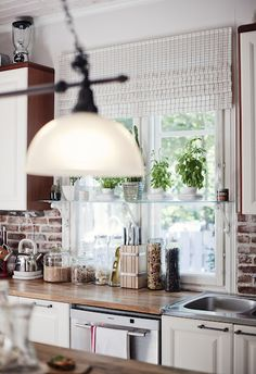 I really like this kitchen, I think this is what i want to do. Wood counters and brick tiling.