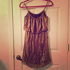"""☀️FINAL✂️Bronzed Gold Shimmery Summer Dress Bronzed gold shimmery spaghetti strap lined summery dress with a stretchy elastic waist & fluttery piece over bust. Measures 17"""" across the bust (not stretchy anywhere but the waistband), & 35"""" long. Sz S in Jrs (or XS in Misses). By Ali & Kris Ali & Kris Dresses"""