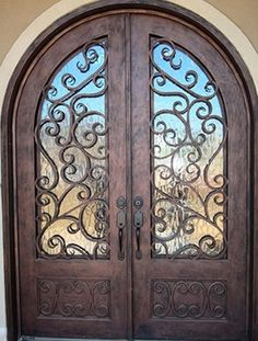 rustic wooden doors, with wrought iron and glass