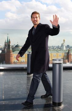Paul Walker waved to cameras while arriving for a Fast & Furious photocall in Moscow in March 2009.