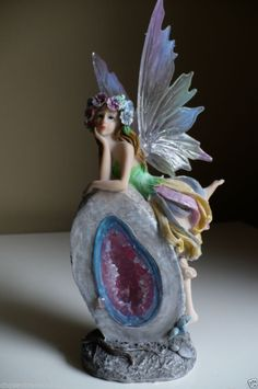 FAIRY laying on GARDEN ROCK FAERIE VILLAGE 10 IN.RESIN  GLOWING GARDEN STONE