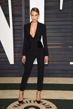 Hannah Davis in a black suit at the Vanity Fair Oscars afterparty
