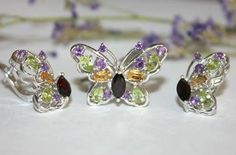 Silver set with rhodium finish. Rocks : amethyst, chrysolite, citrine, garnet. 221$
