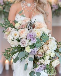Old-world romance and a muted colour palette inspired Brittany of Fancy Face Inc's #bouquet. Composed of #roses, #dahlias, leucadendron, accents of trailing eucalyptus, and tied with lace and satin ribbons, it was a botanical showstopper! See more on WedLuxe.com today and in our new S/F 2016 issue on newsstands NOW! | Photography by: Amsis Photography, Planning: Lexington and Co, Floral: Rachel A. Clingen | WedLuxe Magazine | #wedding #luxury #weddinginspiration #floral #bouquet