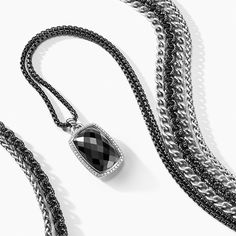 Albion® pendant with black onyx and diamonds.