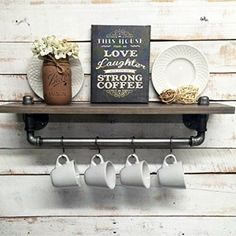 Industrial pipe wall shelves for a rustic farmhouse coffee bar in your home.