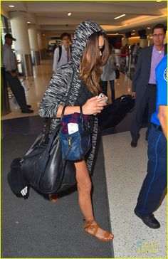 Nina Dobrev keeps her sunglasses on and her hood up while arriving at LAX Airport on Wednesday afternoon (September 17) in Los Angeles