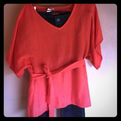 Coral color lightweight sweater I believe this to be Avon brand sweater. Lightweight knit. Tag says the small medium. Short sleeve, V-neck belts at the waist. Avon Sweaters V-Necks