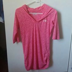 Semi fitted UA shirt Semi fitted 3/4 sleeve pink hooded shirt. Super cute with bunching on the sides. Size xs but has stretch and fits up to a Medium. Great condition. Under Armour Tops Tees - Long Sleeve