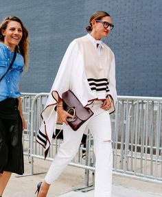 Gorgeous cape-shirt! J. Crew since Jenna Lyons is wearing it??? Notice what looks like red leather binding all the way around. Courtney Crangi and Jenna Lyons