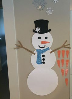 Pin the carrot on the snowman