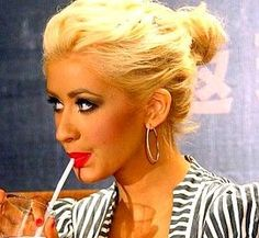 Christina Aguilera hair. messy bun. blonde. smokey eye. red lip. classic.