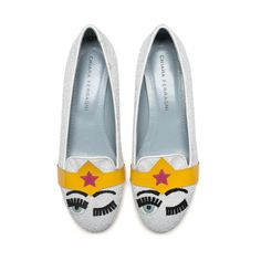 "White glitter ""Flirting"" slippers with patent and suede embroideries and yellow and fuchsia patent band; ton-sur-ton glitter covered heels. Light blue leather lining and insole. Made in Italy"