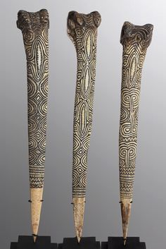 """Abelam Cassowary Bone Daggers.  This set of three Abelam cassowary bone daggers with individually etched motif are beautiful examples of the intricacy the Abelam people create. Bone is recognized as a metaphor for strength, with a narrow range of material to be used, bone was a very valuable material with its strength derived from the powers of the supernatural world and often used in ritual and magic. Dimensions:1 x 14"""" x 2"""", 2 x 13"""" x 2"""" Location:Abelam, Papua New Guinea, Sepik River…"""