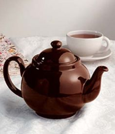 """There are fancier teapots, but none brews a better cup of tea. As you add boiling water, the shape causes the leaves to gently swirl around, creating the perfect flavor and bouquet. Red clay with a Rockingham glaze, handmade in Stoke-on-Trent (home of the Brown Betty since the 1600s). 36-oz. pot brews six cups. 6 1/4"""" high. Hand wash and air dry."""
