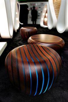 LED lit wooden stools.