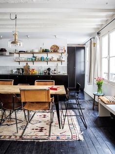 Rustic dining space and kitchen with open shelving