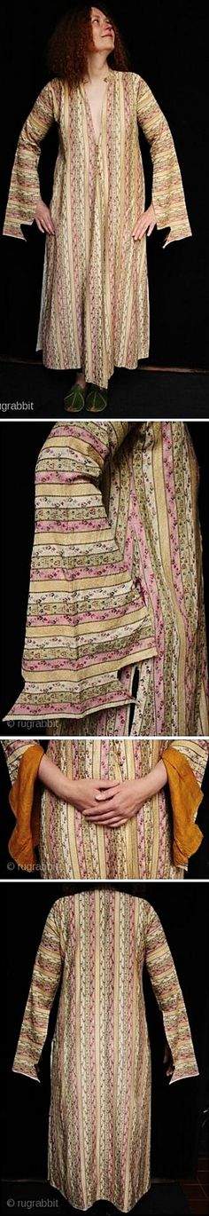 A late-Ottoman 'üçetek' (robe with three panels), purchased in Ürgüp (Cappadocia), but possibly brought in from elsewhere in Anatolia.  Urban style, c. early 20th century.  The fabric is 'kutnu' silk (probably from Gaziantep). The pastel coloured textile from which the robe is made is woven with an abstracted flower motif and is entirely hand stitched with a pocket on the right, silk buttons and fine orange silk lining to the sleeves. Size: 134cm long, and 54cm from shoulder to shoulder.