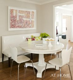 all white dining nook, mixed bench and mod chairs
