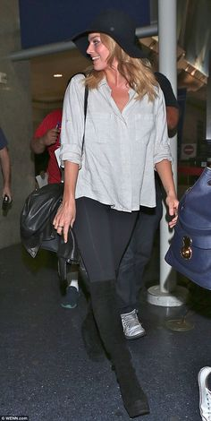 Warm welcome: Crowds of photographers met Margot Robbie when she arrived at LAX on Saturday