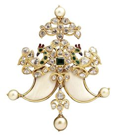 Peacock brooch by Sunita Shekhawat with diamonds, rubies, emeralds, onyx and pearls.