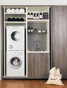 Modern Laundry room design with contemporary coloring and storage cabinets.