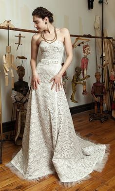 Swanilda gown in ivory lace and nude silk lining? Elegant and ready for her New Year's Eve wedding. Tres chic!