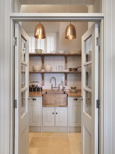Small Kitchen Ideas - A small-space Artisan kitchen that incorporates lots of storage, a dishwasher, oven, coffee machine and hand-beaten copper sink. Kitchen And Bath, New Kitchen, Kitchen Dining, Kitchen Decor, Kitchen Cabinets, Kitchen Pantry, White Cabinets, Kitchen Sinks, Kitchen Nook