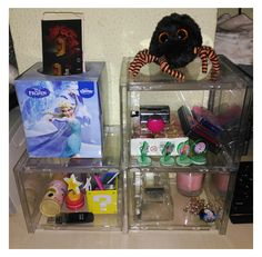 DIY display shelf with old CD cases! You can use glue and optional tape. Extra tip: Use your old tiny handkerchief case for bookmarks!
