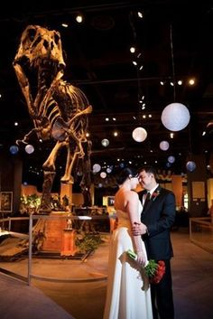 Wedding at Orlando Science Center- lighting in the dinosaur room for reception. Florist added the lantern lights and string lights.