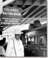 The Court's decision in Plessy v. Ferguson ushered in an era of legally sanctioned racial segregation. Above, an African American man stands...