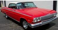 Own a Classic cherry red Chevy with bucket seats.