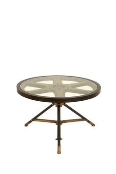 antique brass side table with movie projector wheel design