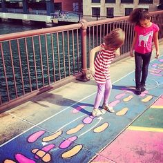 "Dance Spot is an interactive public art piece that transforms Fort Point sidewalks into colorful dance floors. It involves a series of five ""dance spots"" prominently located throughout the Fort Point neighborhood, each with a dance diagram drawn on the sidewalk with color-saturated chalks. Paired with a particular song, passersby can access an online component  via QR code. #Placemaking #Creative #LQC #Interactive"