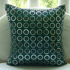 Teal and silver cushion from Etsy