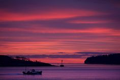 2012 Year in Review > A lobster boat heads out to sea at dawn, Friday, Dec. 7, 2012, of South Portland, Maine