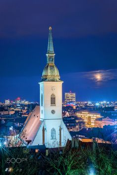 Cathedral in the full moon | Bratislava, Slovakia - St. Martin's Cathedral during blue hour with full moon background.