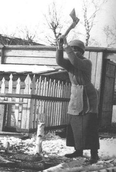 Olga chopping wood in Tobolsk