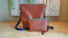 Leather messenger bag and matching wristlet  Check out this item in my Etsy shop https://www.etsy.com/listing/492023734/genuine-leather-messenger-bag-and