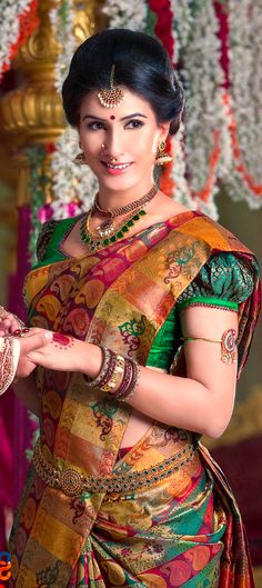the bride is the most important person on the wedding day, these blouse designs will make you feel more. Here is a list of 30 awesome bridal blouse designs that you can choose from. Indian Bridal Fashion, Indian Bridal Wear, Indian Wear, South Indian Weddings, South Indian Bride, Desi Wedding, Saree Wedding, Telugu Wedding, Bridal Sarees