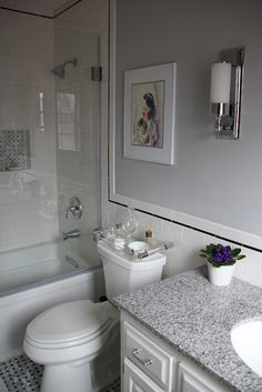 This is exactly how I would do my bathroom if i was able to renovate it.  Still keeping with the period the house was built but cleaned up and refreshed.  Perfect.