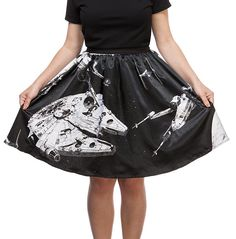 Show off your support for the rebels with this fully-lined satin weave Star Wars skirt. Its black-and-white color scheme includes the X-Wing Fighter and the Millennium Falcon, and has a section of elastic at the waist for a custom fit.