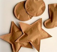 Party favour idea - sews paper parcels filled with sweets ... LOVE!  Cheap and can easily be jazzed up with a cute little felt heart or ribbon on the front.  Could also use these on the table, the kids would love them.