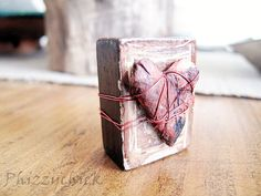 A litle altered wooden block containing a red wire wrapped heart.    A sweet way to let your sweetie know that you love them.    This wooden block