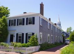 Martha's Vineyard vacation rental. Sleeps 8. Classic antique house on South Water Street, in Edgartown.  Private yard, water views, 3 bedrooms, over-sized, fully equipped kitchen, partners desk in study.