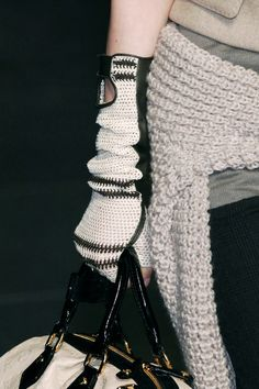 Louis Vuitton Fall 2006 - pic only; like the scrounged up n opening and fastening on the front of the gloves