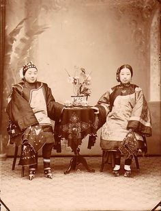 CHINA IN 1890. Pay attention to their lily foot bound feet and their silk attire. Possibly photo of a wealthy family.