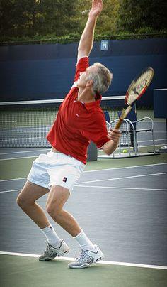 John McEnroe serving