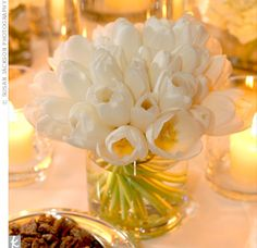 White Tulip Centerpiece for a Black and White Wedding. I love how simple and warm this looks.